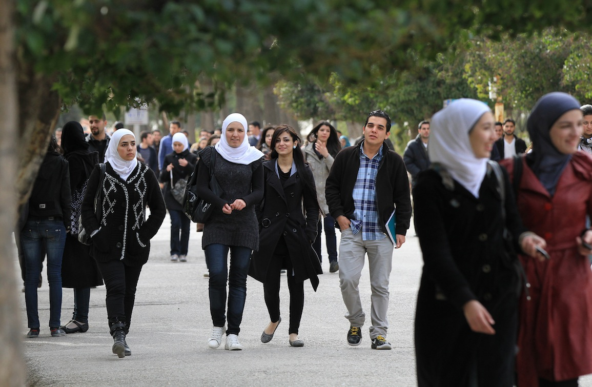 Syrian students walk on campus at the faculty of engineering in a Damascus university February 23, 2012, as the Britain-based Syrian Observatory for Human Rights said at least 52 people, most of them civilians, were killed in violence across the coutnry.  AFP PHOTO/LOUAI BESHARA (Photo credit should read LOUAI BESHARA/AFP/Getty Images)
